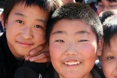 De pret straalt ervan af Beijing met kinderen