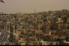Amman skyline vanaf citadel Jordanië met kinderen